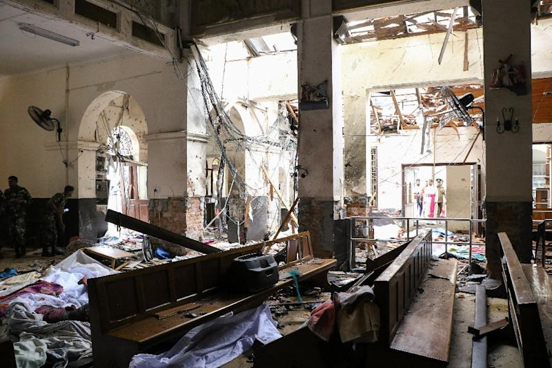 All three churches, including St. Anthony's Shrine, were left in ruins, bodies slumped over pews or lined up in aisles, torn bibles strewn over the floor (AFP Photo/ISHARA S.  KODIKARA)