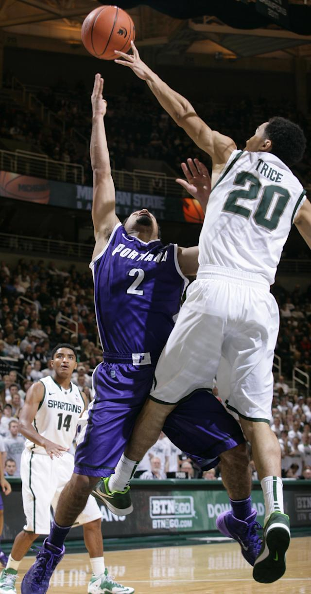 Portland Alec Wintering (2) shoots against Michigan State's Travis Trice (20) during the first half of an NCAA college basketball game, Monday, Nov. 18, 2013, in East Lansing, Mich. (AP Photo/Al Goldis)