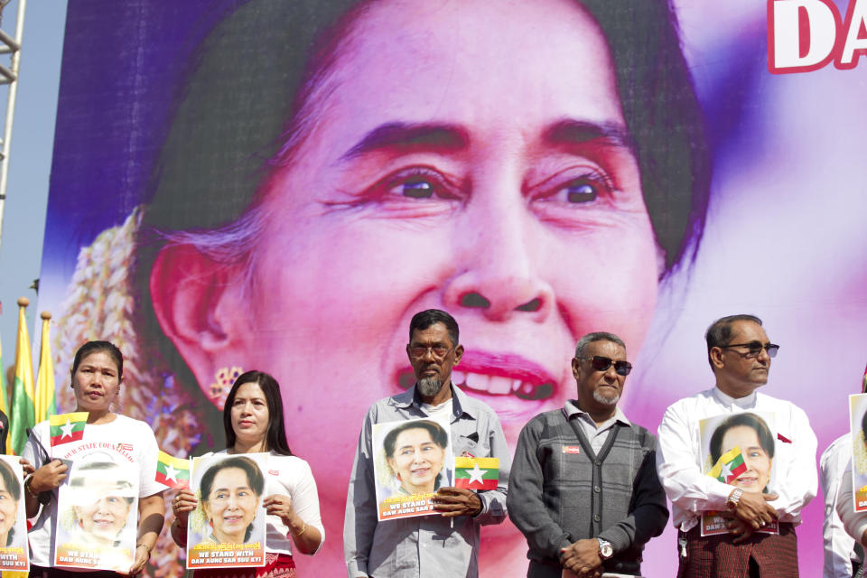 FILE - In this Tuesday, Dec. 10, 2019 file photo, Members of Myanmar Muslims community hold portraits of Myanmar leader Aung San Suu Kyi to pray as they gather in front of City Hall in Yangon, Myanmar. The U.N. General Assembly approved a resolution Friday, Dec. 27, 2019 strongly condemning human rights abuses against Myanmar's Rohingya Muslims and other minorities, including arbitrary arrests, torture, rape and deaths in detention. (AP Photo/Thein Zaw, File)