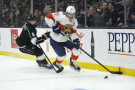 Florida Panthers center Aleksander Barkov, right, tries to pass the puck while under pressure from Los Angeles Kings defenseman Drew Doughty during the first period of an NHL hockey game Thursday, Feb. 20, 2020, in Los Angeles. (AP Photo/Mark J. Terrill)