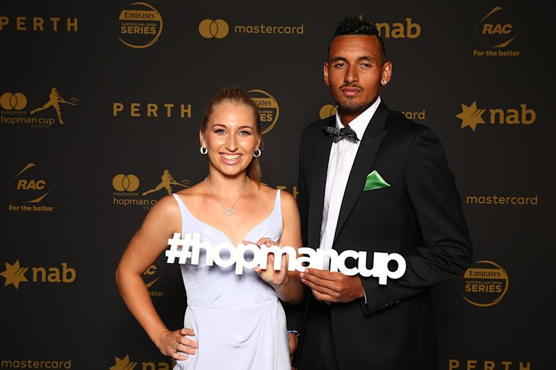 Daria Gavrilova and Nick Kyrgios pose for a photo.