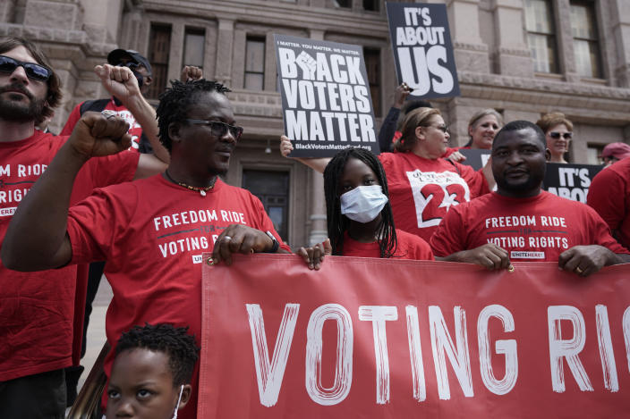 A group joins a rally to support voter rights on the steps of the Texas Capitol, Thursday, July 8, 2021, in Austin, Texas. The Texas Legislature began a special session Thursday. (AP Photo/Eric Gay)