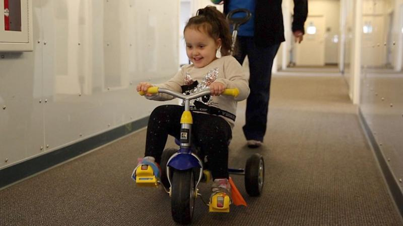 Girl with spina bifida who wasn't expected to walk loves running and kicking goals