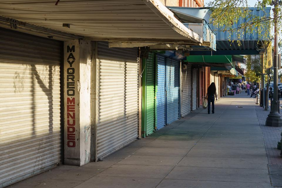 A pedestrian walks down a major shopping street in downtown El Paso, Texas on October 23, 2020. County officials enacted a curfew this week in the wake of a surge in cases. (Photo by Paul Ratje/AFP)