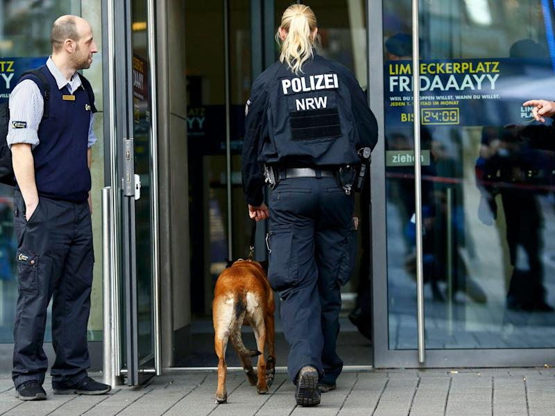 Dogs begin searching Limbecker Platz shopping mall in Essen, Germany, yesterday (Reuters)