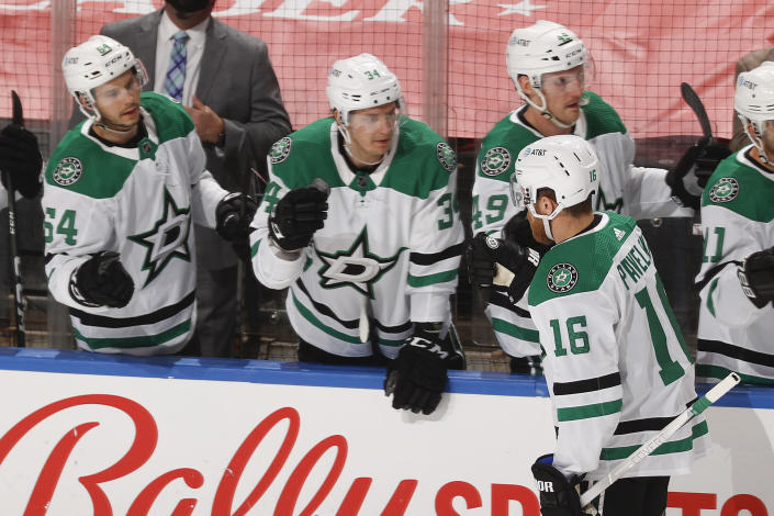 Teammates congratulate Dallas Stars center Joe Pavelski (16) after he scored a goal against the Florida Panthers during the first period of an NHL hockey game, Monday, May 3, 2021, in Sunrise, Fla. (AP Photo/Joel Auerbach)