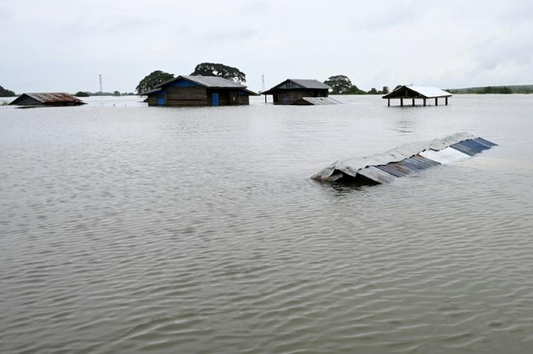 Houses have been submerged by floodwaters in Shwegyin township of the Bago Region in Myanmar (AFP Photo/Ye Aung THU)