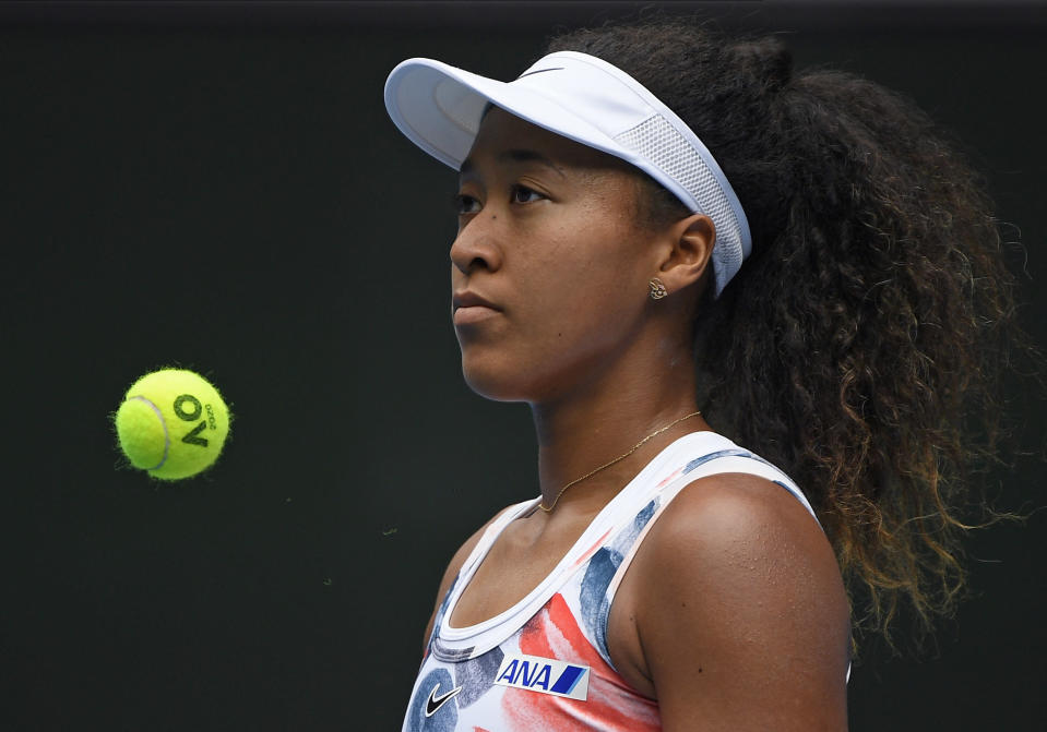 Japan's Naomi Osaka waits to serve to China's Zheng Saisai during their second round singles match at the Australian Open tennis championship in Melbourne, Australia, Wednesday, Jan. 22, 2020. (AP Photo/Andy Brownbill)