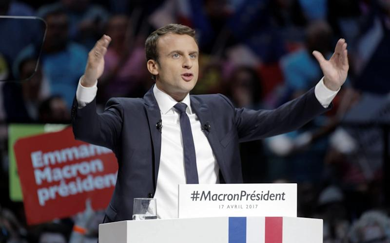 French presidential candidate Emmanuel Macron gestures as he delivers a speech during a campaign rally at Bercy Arena on April 17, 2017 in Paris - Getty Images Europe