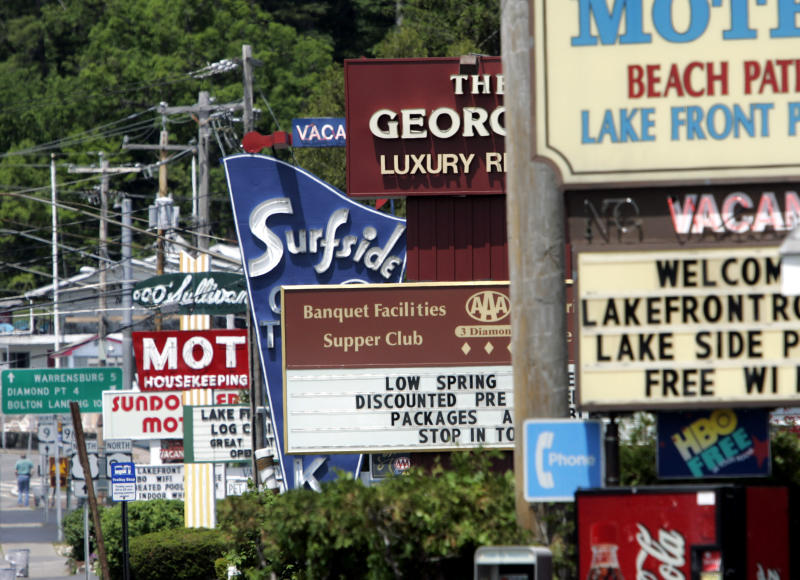 FILE - In this Tuesday, May 26, 2009 file photo, motel signs are seen in Lake George, N.Y.  Airlines, hotels and campgrounds are expecting to see more customers in 2013 than in the previous few summers. (AP Photo/Mike Groll, File)