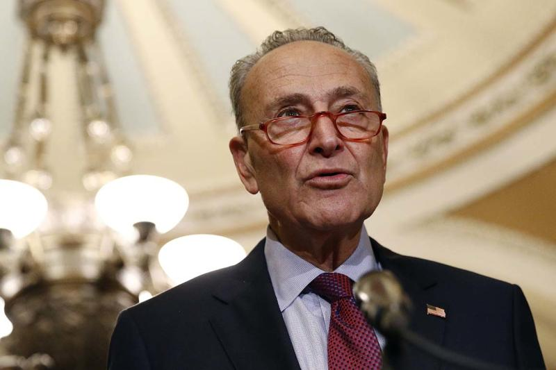 In this Oct. 22, 2019, photo, Senate Minority Leader Sen. Chuck Schumer of N.Y., speaks to members of the media following a Senate policy luncheon on Capitol Hill in Washington. Schumer is moving Democrats' climate talk to where the rubber meets the road, proposing a $462 billion trade-in program to get millions of Americans out of climate-damaging gas vehicles and into electric or hybrid cars over the next decade. (AP Photo/Patrick Semansky)