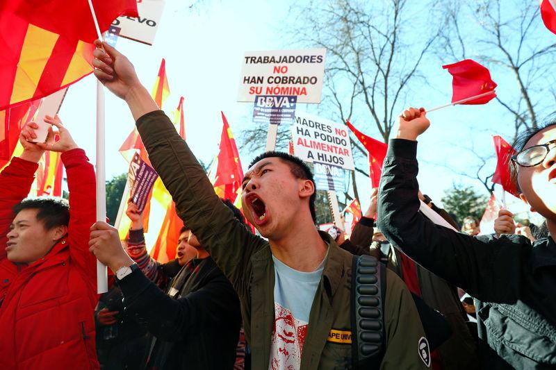 Chinese customers of Spanish bank BBVA protest outside its headquarters in Madrid