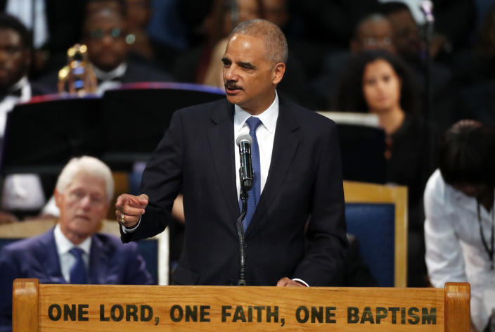 Former U.S. Attorney General Eric Holder speaks during the funeral service for Aretha Franklin at Greater Grace Temple, Friday, Aug. 31, 2018, in Detroit. Franklin died Aug. 16, 2018 of pancreatic cancer at the age of 76. (AP Photo/Paul Sancya)