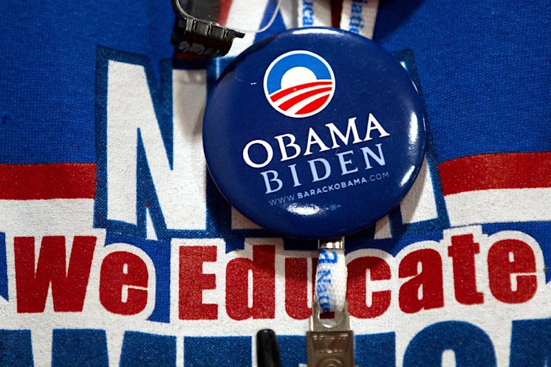 A participant at the National Education Association's annual convention wears a pin supporting President Barack Obama, in Washington, on Thursday, July 5, 2012. (AP Photo/Jacquelyn Martin)