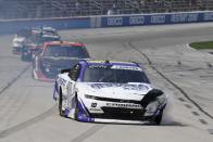 Jeb Burton, front, leaves a smoke trail after crashing during a NASCAR Xfinity Series auto race at Texas Motor Speedway in Fort Worth, Texas, Saturday, June 12, 2021. (AP Photo/Larry Papke)