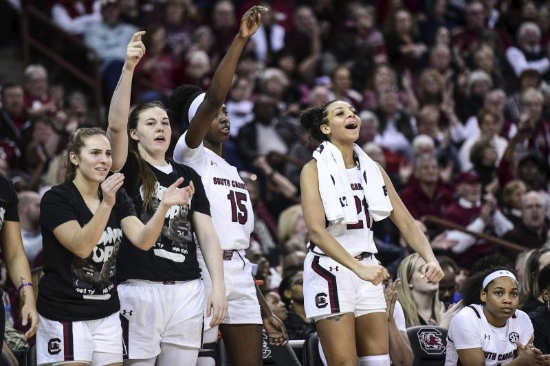 South Carolina forward Mikiah Herbert Harrigan, right, Laeticia Amihere (15), Elysa Wesolek and Olivia Thompson, left, react to a score during the second half of an NCAA college basketball game against Texas A&M, Sunday, March 1, 2020, in Columbia, S.C. (AP Photo/Sean Rayford)