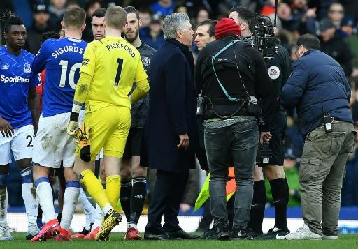 Sent off - Everton manager Carlo Ancelotti (C) remonstrates with referee Chris Kavanagh (unseen) before being shown a red card in a 1-1 draw with Manchester United