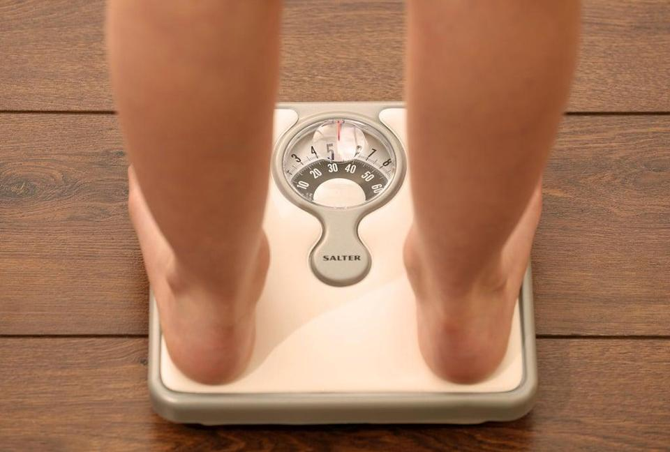 Embargoed to 0001 Tuesday October 11 Picture posed by model File photo dated 03/03/14 of an 11 year old girl using a set of weighing scales as more than 1.6 million children who started secondary school in the past decade were overweight or obese, new calculations show. (PA Archive)