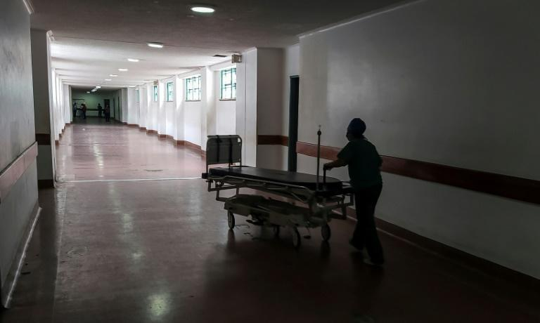 A health worker pushes a stretcher through the corridors of the Clinical University Hospital in Caracas