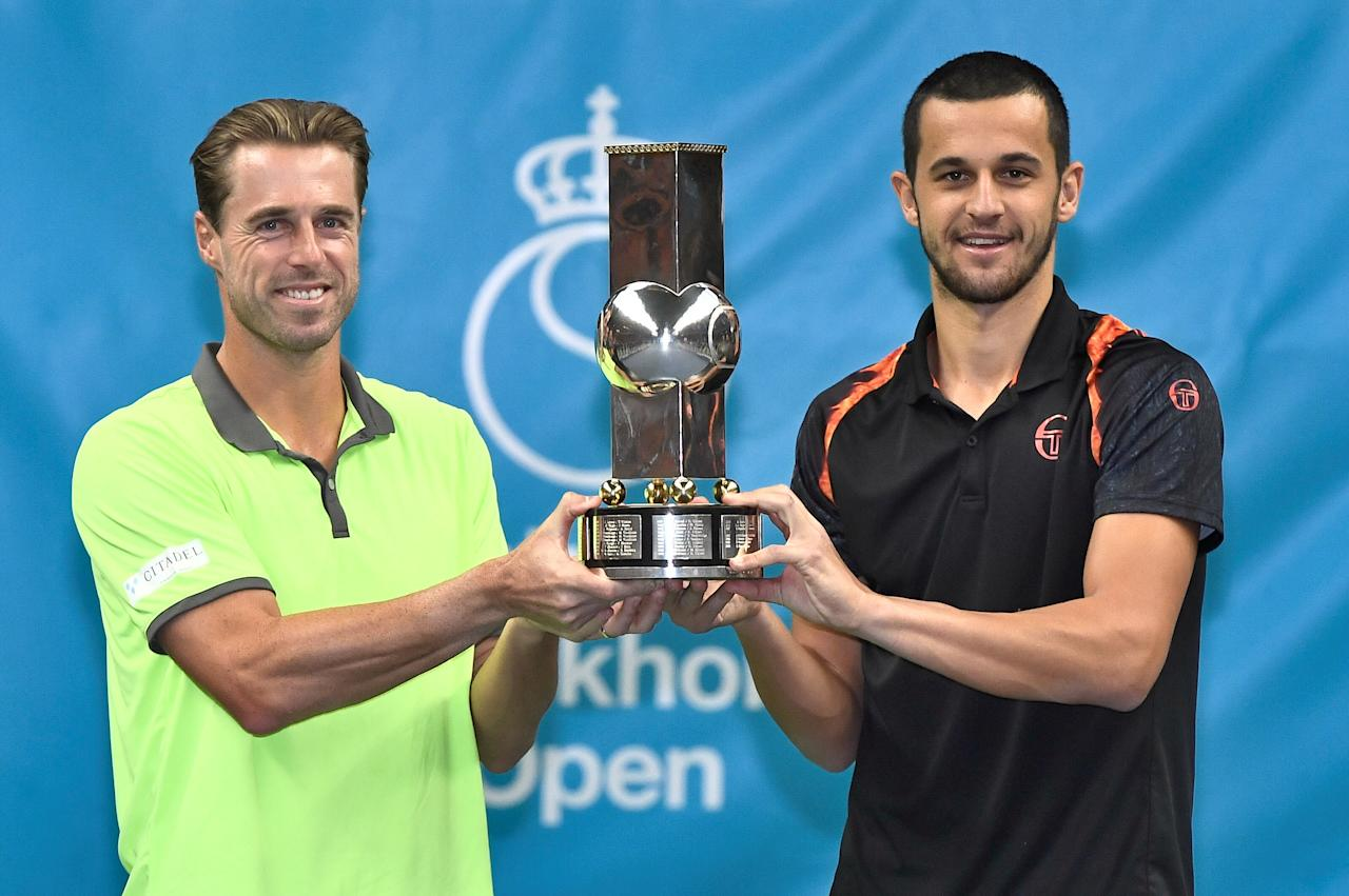 Tennis - Stockholm Open - Men Doubles Final - Royal Tennis Hall, Stockholm, Sweden - October 22, 2017. Mate Pavic of Croatia and Oliver Marach of Austria pose with a trophy after defeating Aisam Ul Haq Qureshi of Pakistan and Jean Julien Rojer of the Netherlands . TT News Agency/Claudio Bresciani/via REUTERS   ATTENTION EDITORS - THIS IMAGE WAS PROVIDED BY A THIRD PARTY. SWEDEN OUT. NO COMMERCIAL OR EDITORIAL SALES IN SWEDEN.