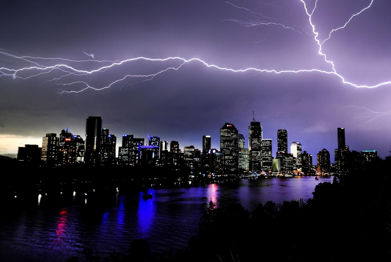 <p>Lightning cuts across the sky above Brisbane, pictured from Kangaroo Point. (Rex) </p>