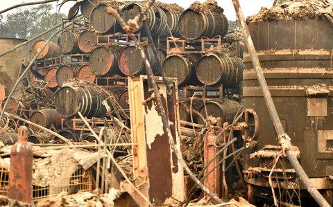 Burned wine barrels are seen at a destroyed Paradise Ridge Winery in Santa Rosa in California - Credit: AFP