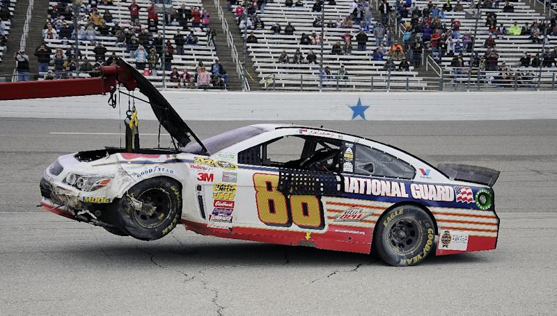Dale Earnhardt Jr.'s (88) car is towed off the track after a wreck during the NASCAR Sprint Cup series auto race at Texas Motor Speedway, Monday, April 7, 2014, in Fort Worth, Texas