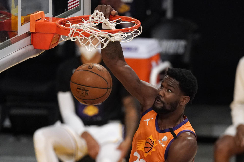 Phoenix Suns center Deandre Ayton dunks during the first half in Game 4 of an NBA basketball first-round playoff series against the Los Angeles Lakers Sunday, May 30, 2021, in Los Angeles. (AP Photo/Mark J. Terrill)