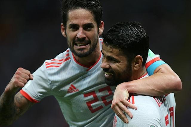 Spain's Diego Costa (R) celebrates his goal with teammate Isco during their Russia 2018 World Cup Group B match against Iran, in Kazan, on June 20 (AFP Photo/Roman Kruchinin)