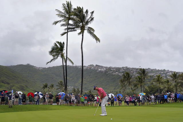 Kevin Kisner putts on the first green during the final round of the Sony Open PGA Tour golf event, Sunday, Jan. 12, 2020, at Waialae Country Club in Honolulu. (AP Photo/Matt York)