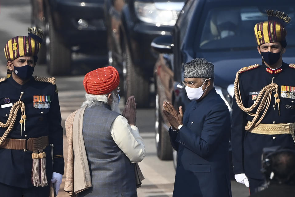 India's Prime Minister Narendra Modi (2L) greets President Ram Nath Kovind as he arrives for the Republic Day parade in New Delhi on January 26, 2021. (Photo by Jewel SAMAD / AFP) (Photo by JEWEL SAMAD/AFP via Getty Images)
