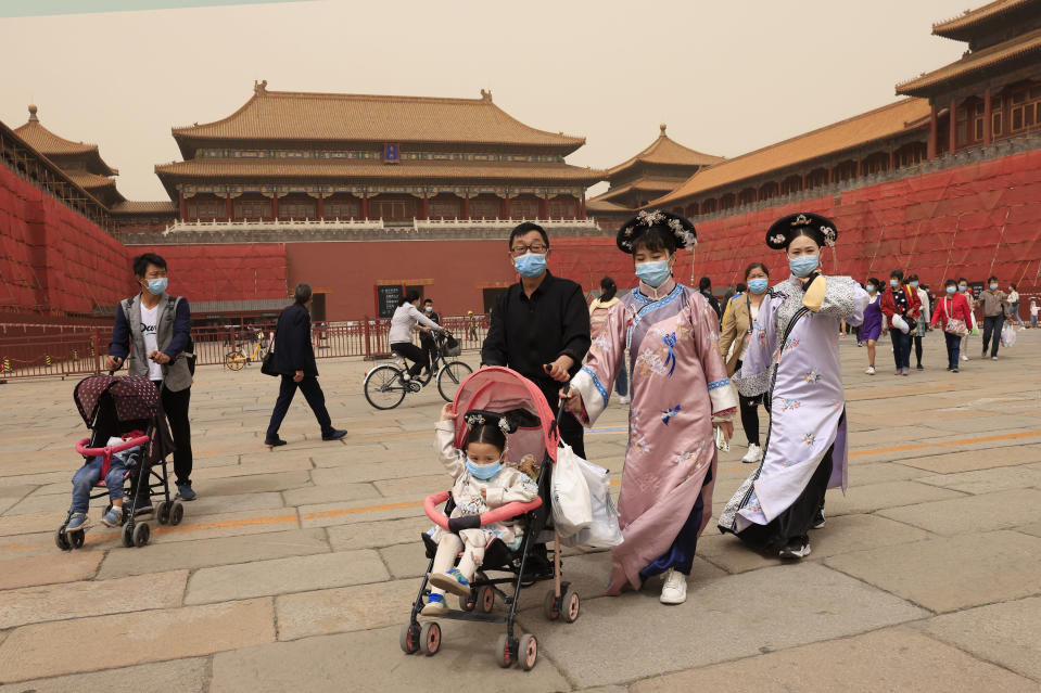 Residents dressed in traditional costumes visit the Forbidden City in Beijing on May 6, 2021. China's population growth is falling closer to zero as fewer couples have children, the government announced Tuesday, May 11, 2021, adding to strains on an aging society with a shrinking workforce. (AP Photo/Ng Han Guan)