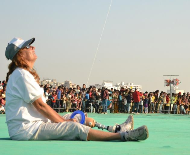"A foreign participant takes pleasure in watching her kite fly. <br><br>Photo by Yahoo! reader <a target=""_blank"" href=""https://www.flickr.com/photos/61545942@N08/"">Nisarg Lakhmani</a>"