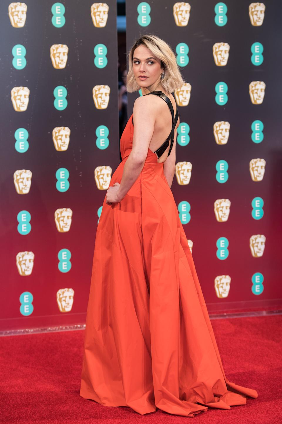 Jessica Brown Findlay poses for photographers upon arrival at the BAFTA Film Awards, in London, Sunday, Feb. 12, 2017. (Photo by Vianney Le Caer/Invision/AP)