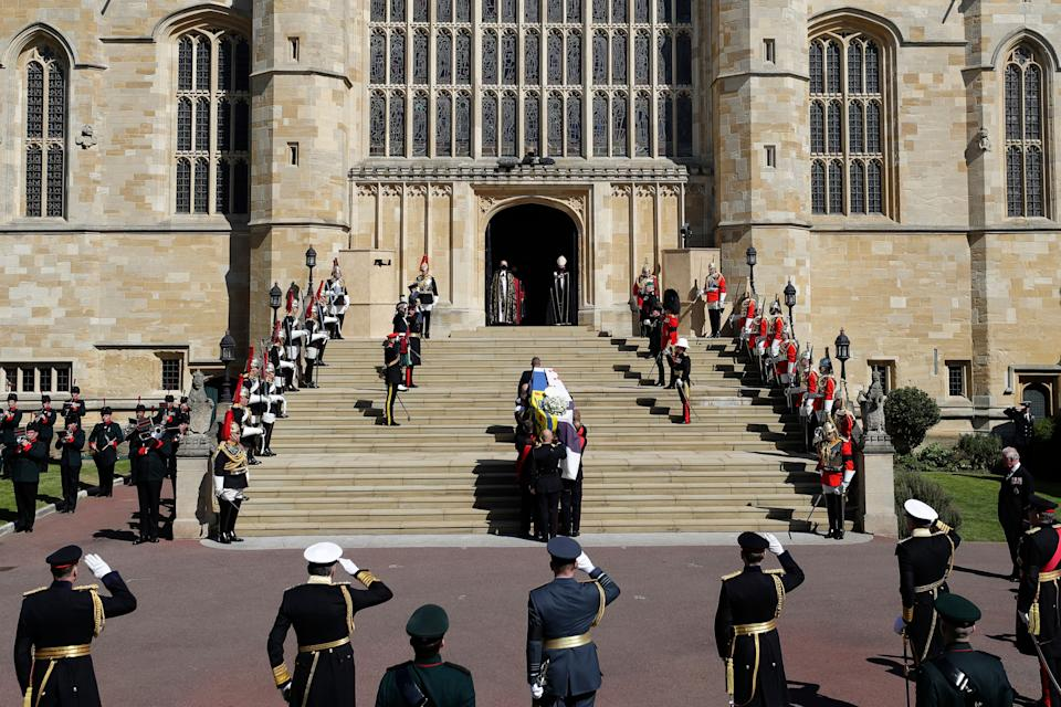 <p>Pallbearers of the Royal Marines carried the coffin up the West Steps of St George's Chapel. (AFP via Getty Images)</p>