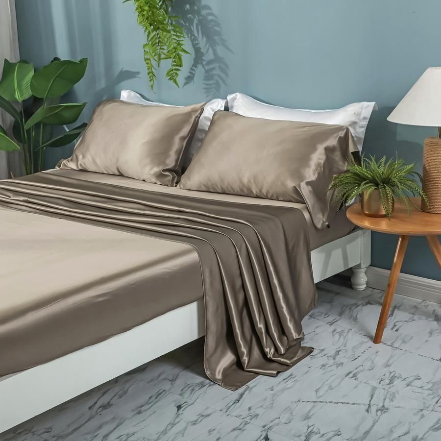 "<p><strong>Zimasilk</strong></p><p>zimasilk.com</p><p><strong>$459.00</strong></p><p><a href=""https://zimasilk.com/collections/silk-bedding-1/products/zimasilk-4-pcs-100-mulberry-silk-bed-sheet-set-all-side-19-momme-silk"" rel=""nofollow noopener"" target=""_blank"" data-ylk=""slk:BUY NOW"" class=""link rapid-noclick-resp"">BUY NOW</a></p><p>Crafted from 19mm mulberry silk, this four-piece set by Zimasilk exudes soft sophistication in an array of hues, including the taupe seen here. The machine-washable sheets flaunt high-tensile strength, withstanding rips and retaining shape longer.</p>"