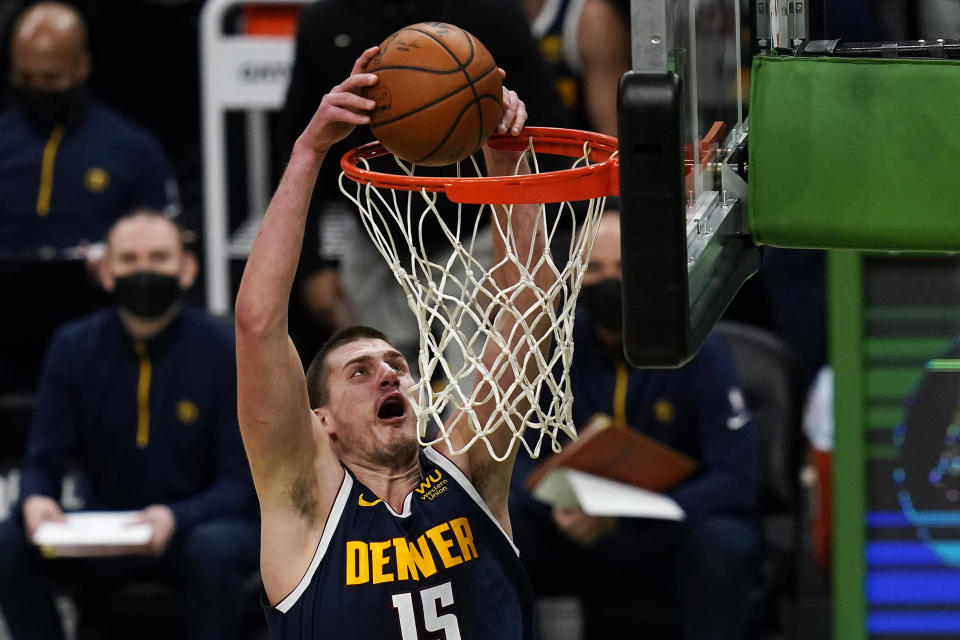 Nikola Jokic dunks with two hands.