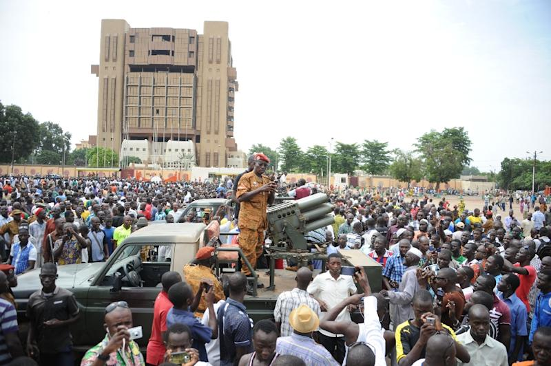 People attend a ceremony marking the end of the disarming process of the Presidential Security Regiment (RSP), on October 6, 2015 in Ouagadougou (AFP Photo/Ahmed Ouoba)