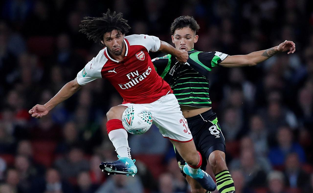 """Soccer Football - Carabao Cup Third Round - Arsenal vs Doncaster Rovers - Emirates Stadium, London, Britain - September 20, 2017   Arsenal's Mohamed Elneny in action with Doncaster Rovers' Niall Mason    REUTERS/Eddie Keogh    EDITORIAL USE ONLY. No use with unauthorized audio, video, data, fixture lists, club/league logos or """"live"""" services. Online in-match use limited to 75 images, no video emulation. No use in betting, games or single club/league/player publications. Please contact your account representative for further details.     TPX IMAGES OF THE DAY"""