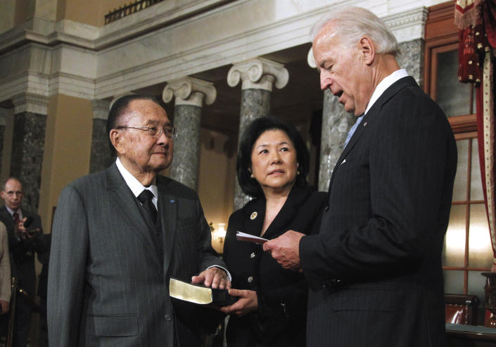 FILE - In this Jan. 5, 2011, file photo Vice President Joe Biden administers a ceremonial Senate oath of office during a mock swearing-in ceremony to Sen. Daniel Inouye, D-Hawaii, left, accompanied by his wife Irene Hirano, in the Old Senate Chamber on Capitol Hill in Washington. Hirano Inouye, the widow of the late senator and the founding CEO of the Japanese American National Museum in Los Angeles, died in Los Angeles on Tuesday, April 7, 2020. She was 71. Hirano Inouye had most recently served as president of the U.S.-Japan Council, which aims to develop and connect leaders to strengthen the U.S.-Japan relationship. (AP Photo/Manuel Balce Ceneta, File)