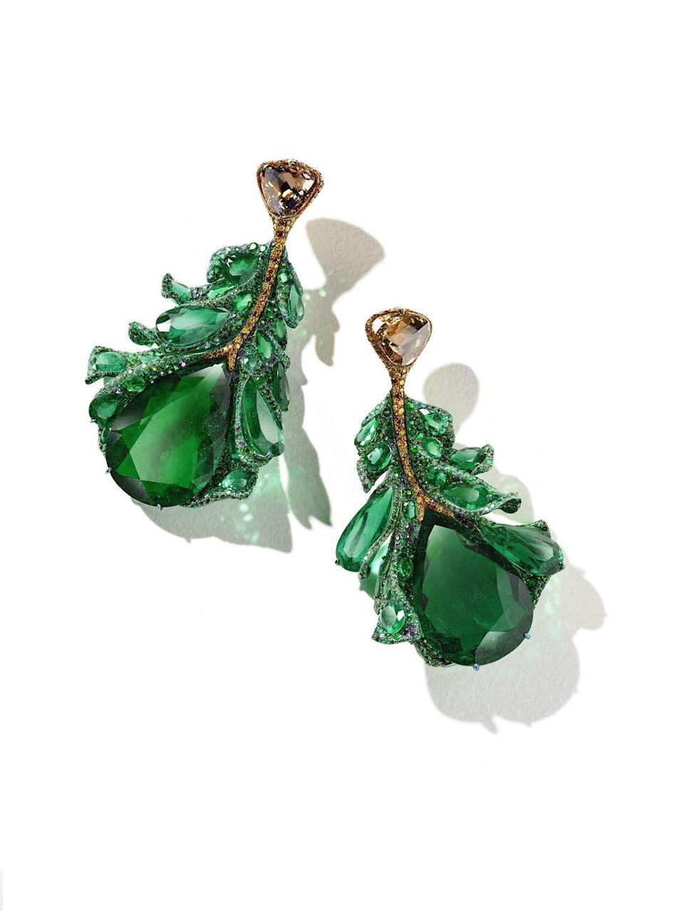 """<p>Jewelry artist <a href=""""http://cindychao.com/"""" rel=""""nofollow noopener"""" target=""""_blank"""" data-ylk=""""slk:Cindy Chao"""" class=""""link rapid-noclick-resp"""">Cindy Chao</a> held on to a pair of exceptional 90-carat pear-shaped vivid green Colombian emeralds for over a decade, waiting for inspiration. This year, it finally came. She set the stones in the Green Plumule earrings and unveiled them during couture week. Each stone is surrounded by tsavorites, alexandrites, and color-changing garnets. Even with 2,291 stones, the earrings retain graceful flexibility and lightness. Another pair of rare conch pearls are featured in the Cameron Falls earrings, which are set in titanium with streams of pink sapphires, purple garnets, and rose-cut colorless and fancy colored diamonds.</p>"""