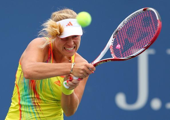 Angelique Kerber of Germany returns a shot against Sara Errani of Italy during their women's singles fourth round match Day Eight of the 2012 US Open at USTA Billie Jean King National Tennis Center on September 3, 2012 in the Flushing neighborhood of the Queens borough of New York City. (Photo by Cameron Spencer/Getty Images)