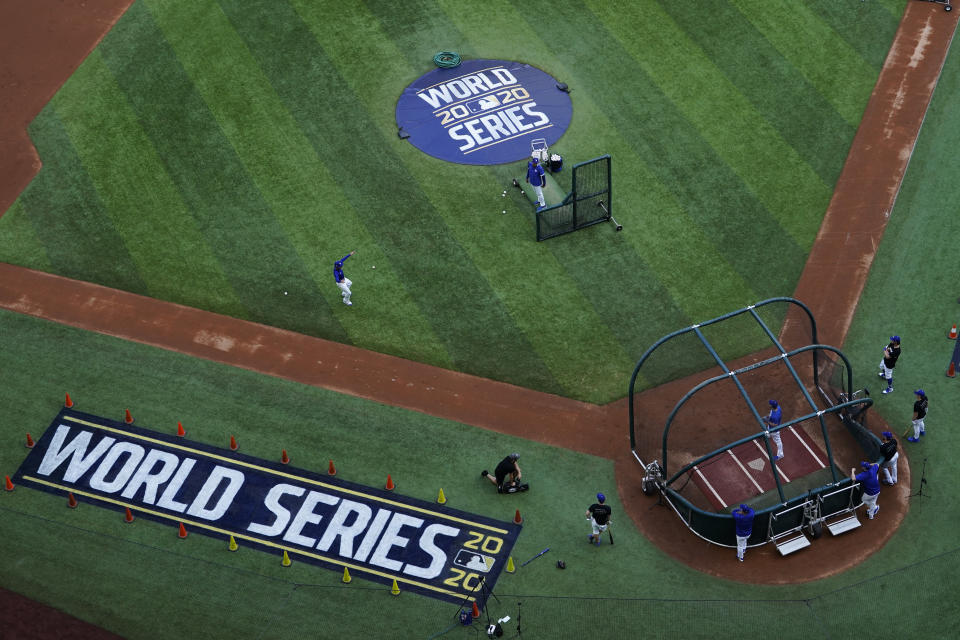 Members on the Los Angeles Dodgers take warms up during batting practice before Game 1 of the baseball World Series Series against the Tampa Bay Rays Tuesday, Oct. 20, 2020, in Arlington, Texas. (AP Photo/David J. Phillip)