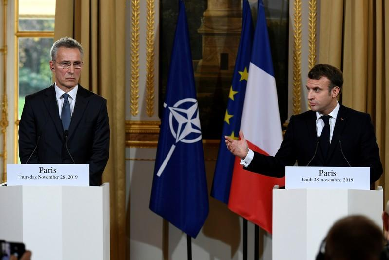 French President Emmanuel Macron and NATO Secretary General Jens Stoltenberg give a news conference after their meeting at the Elysee palace in Paris