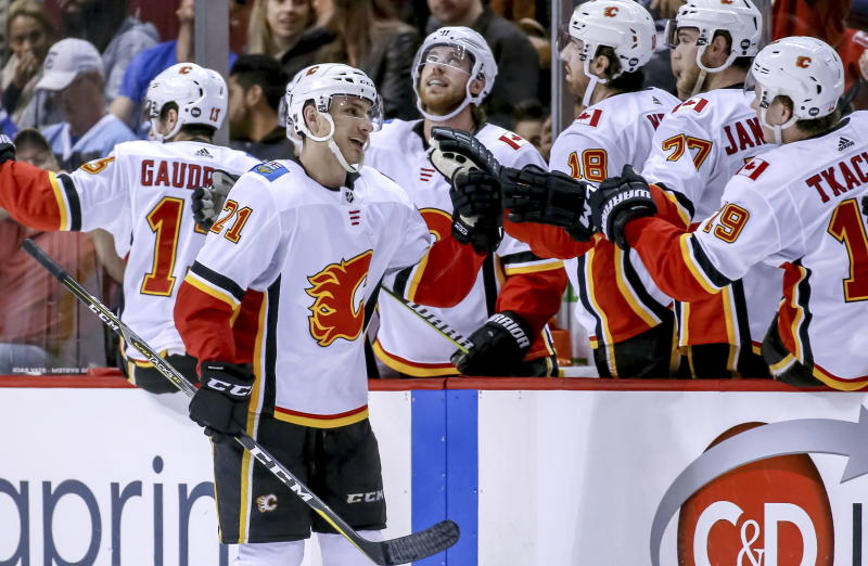 Calgary Flames' Garnet Hathaway (21) celebrates his goal with teammates during the second period of an NHL hockey game against the Vancouver Canucks on Saturday, March 23, 2019, in Vancouver, British Columbia. (Ben Nelms/The Canadian Press via AP)