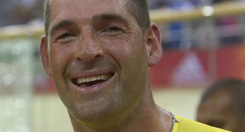 Paralympic gold medallist, 47, dies after auto slams into his bike