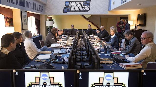"<p>Right now as you're reading this, 10 men and women—a mix of athletic directors and conference commissioners—are hard at work building college basketball's defining event. The decisions that group makes on Sunday, March 11, will shape the next three weeks and ultimately influence the history books.</p><p>The NCAA men's basketball Selection Committee has a daunting job. The least we could do is try to understand the process.</p><h3><strong>How does this whole thing work?</strong></h3><p>Yes, that's the perfect place to start. The committee cannot seed and bracket the teams without first selecting which ones will participate. In any given year, it's relatively easy for the committee to include, say, between 62 and 65 of the 68 teams that make the field. First, the 32 conference tournament winners get automatic bids. Every tournament champion from the mighty ACC to the not-so-mighty MEAC gets to put on the dancing shoes, without question.</p><p>From there, the committee must select what it deems to be the 36 best at-large candidates. Most of these are slam-dunks. For example, neither Purdue nor Michigan State won the Big Ten tournament, but both are just as assured of a bid as Michigan, which did cut down the nets in New York last week. Weeks before Selection Sunday, the committee likely already knows at least one-third of the teams that will get at-large bids, if not more. By time Championship Week arrives, chances are there are just a handful of remaining spots up for grabs.</p><p>Those remaining spots are where things get tricky. Bubble teams play a high-stakes game of musical chairs during Championship Week, with X number of teams fighting for Y number of at-large bids. Yes, the Y number is always fewer than the X number. The committee weighs multiple criteria, debating the teams on the bubble before it settles on what it believes to be the final entries to round out the 36 at-large bids and, in turn, the NCAA tournament field. After that, it gets to seeding and bracketing.</p><h3><strong>What are the criteria?</strong></h3><p>The committee will pore over any number of stats and metrics to try to make their team-by-team comparisons as close to apples-to-apples as possible. Some of those will be simple, such as overall record. Some will be a bit more complex, such as computer rankings generated by respected observers of the game. This includes kenpom.com, Sagarin and BPI. Some—such as conference record— will be part of the discussion but carry little weight. Some will act more as tiebreakers, such as non-conference strength of schedule. Again, this is not a job the committee takes lightly. For as much flack as it gets, the committee leaves no stone unturned.</p><p>The most important criteria are a mix of old standbys and new constructs, in an effort to improve the process while not completely ditching what the committee believes works. They are as follows:</p><p><strong>RPI:</strong> Like it or not, the Ratings Percentage Index remains a big part of the selection process. The RPI has been around a long time, and while everyone admits it isn't close to perfect, it's still one of the most important parts of a team's resumé.</p><p><strong>Strength of schedule</strong>: There are 351 Division I basketball teams, all of which play varying non-conference schedules before separating into their 32 conferences for league play. No one schedule is anything close to alike. SOS helps the committee compare schedules as fairly as possible.</p><p><strong>Quadrant 1 and 2 record</strong>: This is a new one. It deserves its own section—see more below.</p><p><strong>Losses outside the top-100 RPI</strong>: Teams separate themselves from the pack, in a positive way, by racking up impressive wins. They do it in a negative way by losing to bad teams, which the committee defines as those with an RPI of 100 or worse. Want to be a high seed? Don't lose to sub-100 teams. Want to be on the right side of the bubble? Don't lose too many games to sub-100 teams. It's pretty simple.</p><h3><strong>What's up with these new Quadrants?</strong></h3><p>The committee needs a way to group wins and losses in a way that helps it compare like teams against one another. Previously, it did so by separating win-loss records against the RPI top 25, top 50, top 100 and top 150, when necessary. However, that system did not account for game location. Is a home win over the No. 25 team in RPI better than a road win over the No. 30 team? Previously, the answer would have been yes, even though anyone who has watched any amount of college basketball knows the road victory is almost certainly the better one.</p><p>The Quadrant system aims to fix that. Every game a team plays will fall into one of four quadrants, based on opponent RPI and game location. They are as follows.</p><p><strong>Quadrant 1:</strong> Home games vs. top 30, neutral games vs. top 50, road games vs. top 75<br><strong>Quadrant 2:</strong> Home games vs. 31-75, neutral games vs. 51-100, road games vs. 76-135<br><strong>Quadrant 3:</strong> Home games vs. 76-160, neutral games vs. 101-200, road games vs. 136-240<br><strong>Quadrant 4:</strong> Home games vs. 161+, neutral games vs. 201+, road games vs. 241+</p><p>No matter if you're Virginia with a guaranteed No. 1 seed or the last team in the field, you shouldn't be losing many Quadrant 3 or 4 games. The committee will be putting a ton of weight on Quadrant 1, or Q1, and Q2 records. You will hear this discussed throughout Selection Sunday. It could very well be the difference between making the field, and settling for the NIT.</p><h3><strong>Are there any other bracketing principles we should know about?</strong></h3><p>Ah, yes, we've come to my favorite part. Of course there are!</p><p>Once the committee selects the 68 teams, it gets to the seeding and bracketing process. This starts by seeding all the teams, one through 68. However, it isn't as simple as slotting the teams into the bracket based on those seeds and calling it a day. In order to account for travel, spread out conferences and avoid rematches, the committee follows certain bracketing principles. We'll go over the most important ones here.</p><p>Geography. Are you a No. 1 or No. 2 seed? Congratulations, the committee is going to do whatever it can to make sure you stay as close to home as possible through the Elite Eight. Villanova could very well end up as the No. 1 or 2 overall seed, and Duke could be no worse than the No. 5 or 6, but they might share the East Region, even though a pure seeding process would pit Villanova against the No. 7 or 8 overall seed. That's because the East Region, hosted in Boston this year, is one of the closest of the four regional spots to Duke's campus in Durham. That same geographic preference trickles down to teams on the 4- and 5-lines in the first and second rounds.</p><p>?</p><p>""But wait,"" you say. ""The South Region is in Atlanta this year. That's much closer to Duke's campus than Boston. Why wouldn't the Blue Devils end up there?"" That brings us to our second crucial bracketing principle. Each of the first four teams from one conference must be in different regions if they are on the first four lines. Duke's first geographic preference may be Atlanta, but so is Virginia's, and they cannot share a region. As a No. 1 seed, the Cavaliers get dibs. As such, Duke cannot be in the South Region. That pushes the Blue Devils to their second geographic preference and, depending on what happens this weekend, North Carolina to its third.</p><p>You'll feel that spirit across the bracket. Teams from the same conference cannot meet before the Sweet 16 if they played twice during the regular season, including the conference tournament. They cannot meet before the Elite Eight if they played one another three times in the regular season. They can meet in the second round if they only played once, but the committee will do what it can to avoid such matchups. The committee will also avoid non-conference rematches in the first round. They are allowed if bracketing principles force it, but they are incredibly rare.</p><p>Finally, the committee may move teams up or down one seed line—or two seed lines in extreme cases, according to the NCAA's principles and procedures—to satisfy all bracketing principles.</p><p>You still with me? Good, because that's it. You're now an expert on the NCAA tournament selection, seeding and bracketing process. As for actually filling out the bracket and whittling the 68 teams down to one, that's a completely different story.</p>"