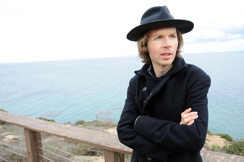 """Musician Beck poses for a portrait at his home on Friday, Dec. 14, 2012, in Malibu, Calif.  Beck Hansen wants you to think about the way music has changed over the last century and what that means about how human beings engage each other these days. Laboring over the intricate and ornate details of his new """"Song Reader"""" sheet music project, he was struck by how social music used to be something we've lost in the age of ear buds. (Photo by Katy Winn/Invision/AP)"""
