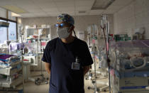 Pediatrician Dr. Hugo Tejerina stands in the intensive care unit of the Women's Hospital maternity ward in La Paz, Bolivia, Thursday, Aug. 13, 2020. Tejerina said oxygen reserves for the infants were almost exhausted last weekend due to nationwide blockades by supporters of the party of former President Evo Morales who object to the recent postponement of elections, but supplies arrived by plane at the last minute. Bolivia's political and social crisis is coinciding with the continued spread of the new coronavirus. (AP Photo/Juan Karita)