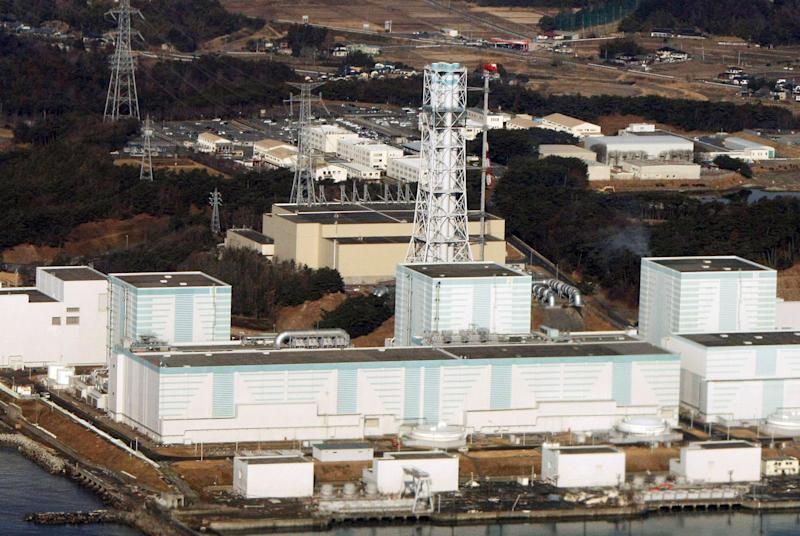 An aerial photo shows the quake-damaged Fukushima Dai-Ni nuclear power plant in the town of Naraha and Tomioka in the Futaba district of Fukushima prefecture on March 12, 2011